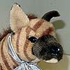 A striped hyena plush toy.
